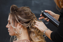 Hairdresser Using Hairspray On...