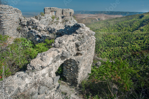 Papiers peints Con. Antique Ancient ruins of Khornabuji Castle over green Alazani valley, Georgia country. Landmark of Kakhetia region