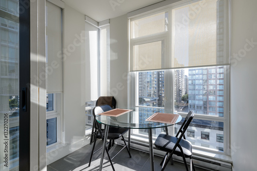 Bright apartment solarium dining room with a view of