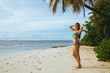 Beautiful sexy girl posing on the beach near the ocean
