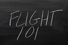 """The Words """"Flight 101"""" On A Blackboard In Chalk"""