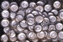 Dirty Recycle Aluminum Drink Cans On Metal Background.