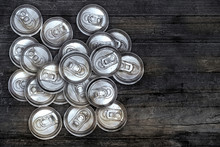 Dirty Recycle Aluminum Drink Cans On Wood Background.