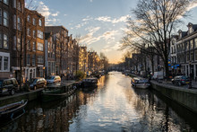 Beautiful Sunset Over Amsterdam, The Netherlands, With Water Canals And Crazy Architecture