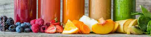 Garden Poster Juice Selection of colourful smoothies on rustic wood background