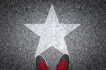 Sneakers On Asphalt Road With ...