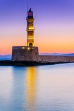 Venetian Lighthouse In Chania Port At Sunrise, Crete, Greece