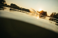 Man Riding Wakeboard On A Lake