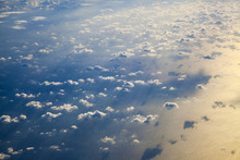Different Clouds Below, View From A Plane