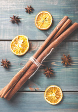 Dried Orange, Anise And Cinnamon Sticks On Green Wooden Table.