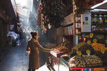 Woman Chooses In The Market Nu...
