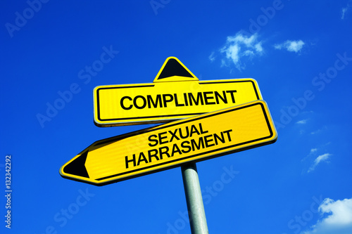 Fotografía  Compliment vs Sexual Harassment - Traffic sign with two options - offensive insu
