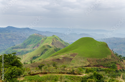 Rolling fertile hills with fields and crops on Ring Road of Cameroon, Africa #132348026