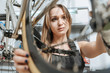 Talented craftswoman repairing the bicycle in the workshop