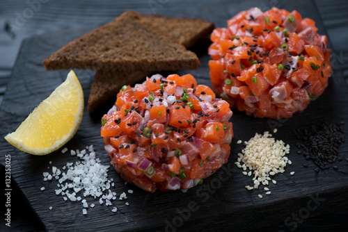 Close-up of salmon tartare served with sesame, bread and lemon Canvas Print
