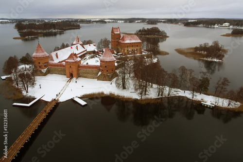 Fotobehang Zen Trakai, Lithuania: aerial winter UAV top view, flat lay of Island Castle in the sunrise. Historical residence in capital city of Grand Duchy of Lithuania, located in Galve lake