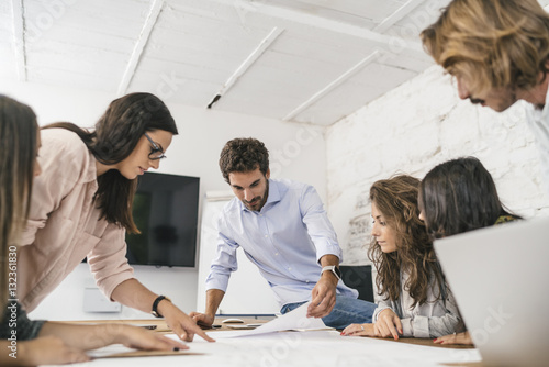 Fotografie, Obraz  Young team of coworkers doing a brainstorming in a modern studio