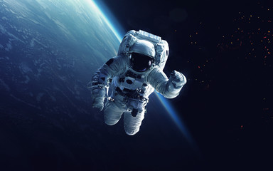 Obraz na płótnie Canvas Astronaut at spacewalk. Cosmic art, science fiction wallpaper. Beauty of deep space. Billions of galaxies in the universe. Elements of this image furnished by NASA