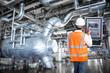 Leinwandbild Motiv Maintenance engineer looking at monitor control in powerhouse
