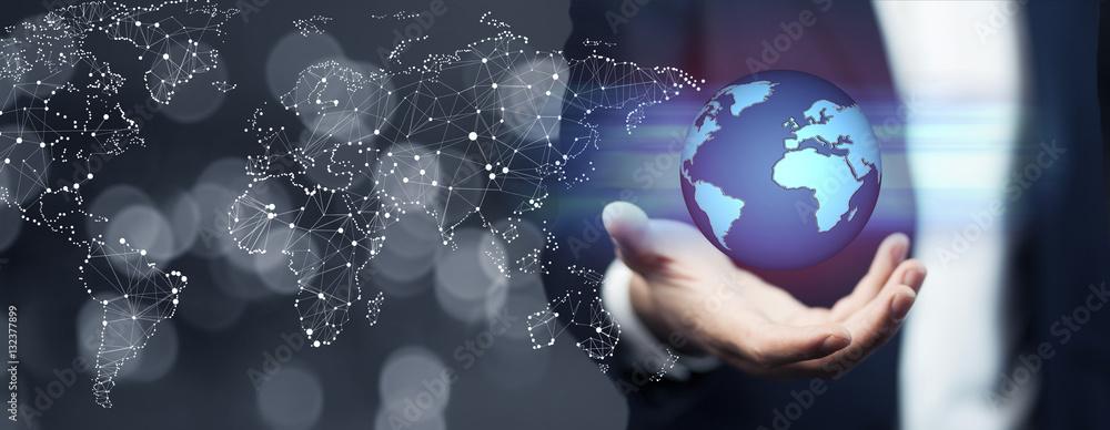 Fototapeta Businessman holding global network