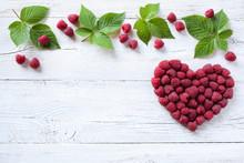 Berries Raspberries In A Heart Shape On Wooden Background