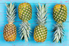 Four Alternating Pineapples On Market Table