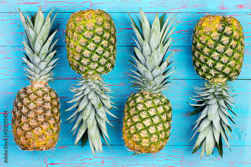 Fotografie, Obraz  Four alternating pineapples on market table