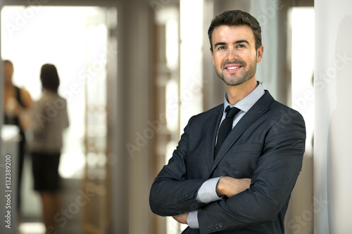 Business man CEO executive at office workplace standing confidently with staff a Фотошпалери