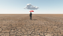 Man In Desert With Umbrella An...