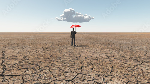 Photo  Man in desert with umbrella and single cloud