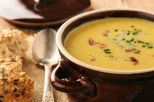 Fotografie, Obraz  Corn cream soup with bacon (chowder) on wooden background.