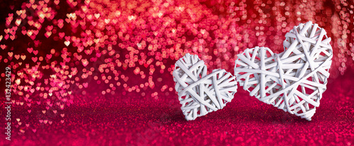 Foto Valentines Day - Wicker Hearts On Red Shiny Background