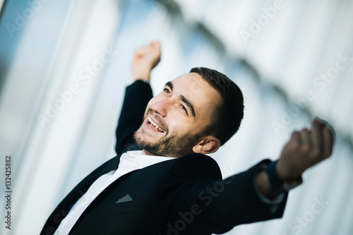 Fotografia Happy Businessman executive raising fists in excitement in office