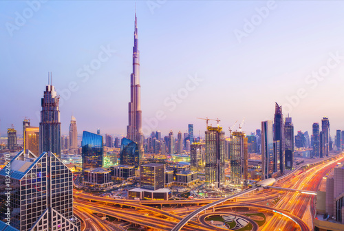 Canvas Print View on modern skyscrapers and busy evening highways in luxury D