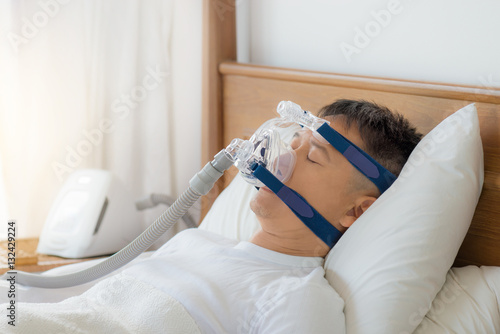 Photo Obstructive sleep apnea therapy, Man wearing CPAP mask
