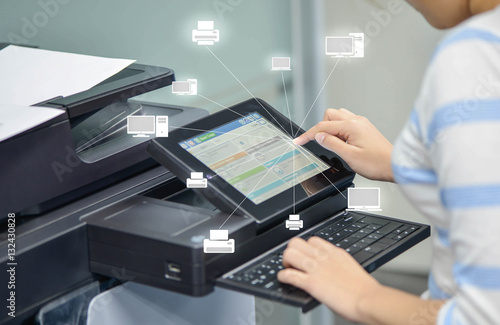 Fotografía  Business woman is using the printer to scanning document to netw