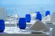 Elegant clean simple white linen restaurant table setting glass silverware china