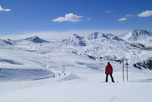 Snowboarding And Skiing On Fresh Snow Slopes In An Alpine Valley, Paradiski, Plagne, Alps, France