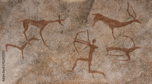 Obraz na plátně Drawing on a rock cave wall ocher paint, ancient prehistoric Neanderthal man