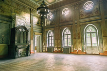 Empty Hall In Sharovsky Castle With Chandelier And Fireplace