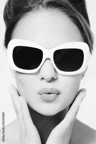 e8ea2c7aa Black and white portrait of young beautiful woman in vintage sunglasses
