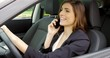 Happy woman talking in car on the phone smiling