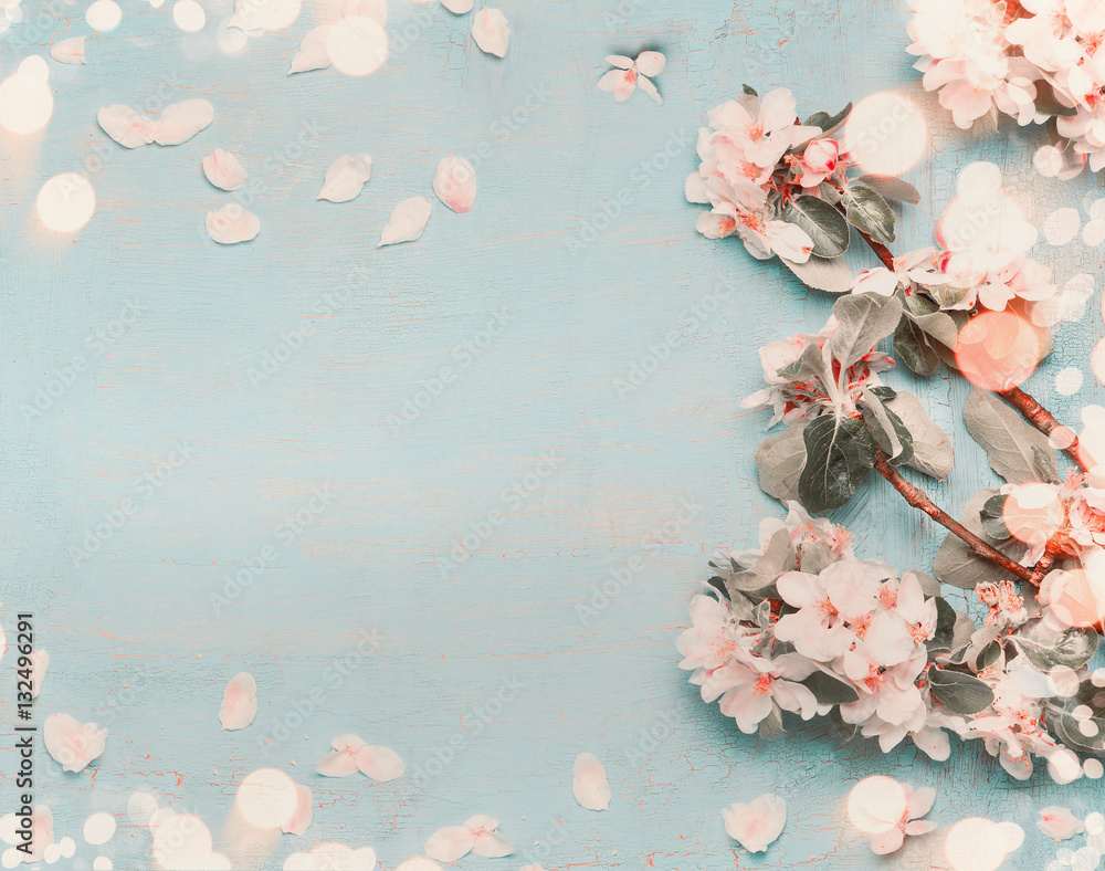 Fototapety, obrazy: Pretty spring blossom on light blue background with bokeh, top view, pastel color, border