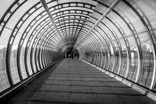 Tunnel Shapped Modern Architecture Tunnel With Light And People At The End