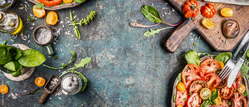 Fototapety, obrazy: Healthy vegetarian salad making preparation with tomatoes on rustic background, top view, banner, copy space