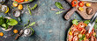 Leinwandbild Motiv Healthy vegetarian salad making preparation with tomatoes on rustic background, top view, banner, copy space
