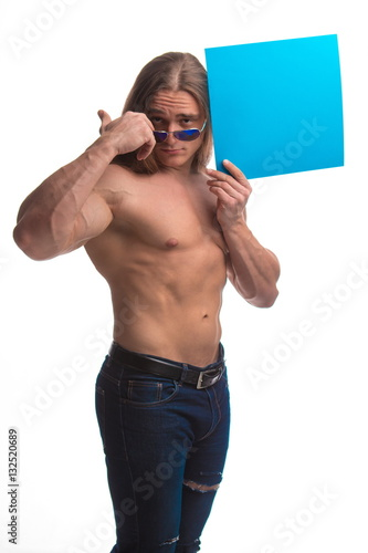 Fényképezés  Portrait of a brutal man bodybuilder athlete with long hair with a sheet of pape
