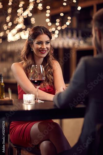 Seductive beautiful lady in bar with boyfriend