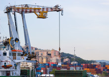 Industrial Port With Containers / Trade Port / A Big Ship Loading Cargo At Port / Cargo Cranes In Industrial Port.
