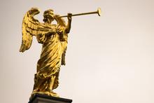 Golden Angel With A Trumpet An...